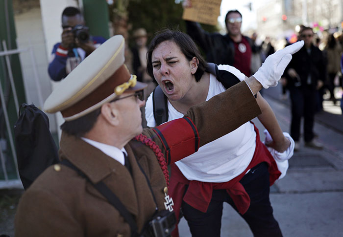 A Woman Yells At A Man Dressed As Adolf Hitler During A Protest Of Newly Inaugurated President Donald Trump At A Women's March Saturday, Las Vegas, 21 January 2017