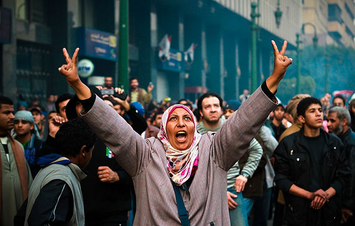 A Woman Protester Waves The Victory Sign During Clashes With Military Police Near Tahrir Square, 17 January 2013