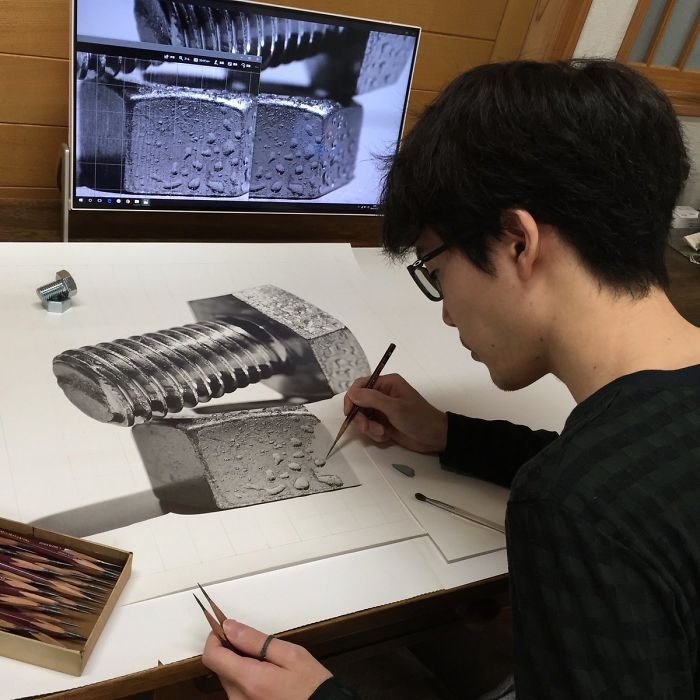 This is 22 year old japanese artist kohei ohmori hard at work on one of his intricate pencil drawings