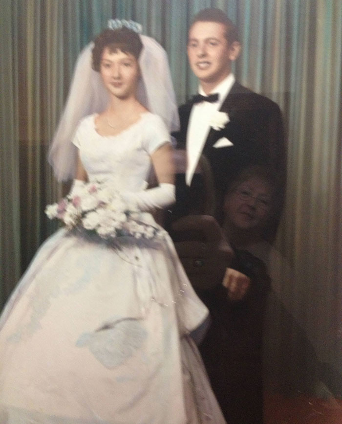 I Was Taking A Photo Of My Boyfriend's Grandparents' Wedding Photo Because I Thought It Was Awesome, And Accidentally Caught The Reflection Of His Grandmother Admiring It, 50 Years Later. I Love This Photo