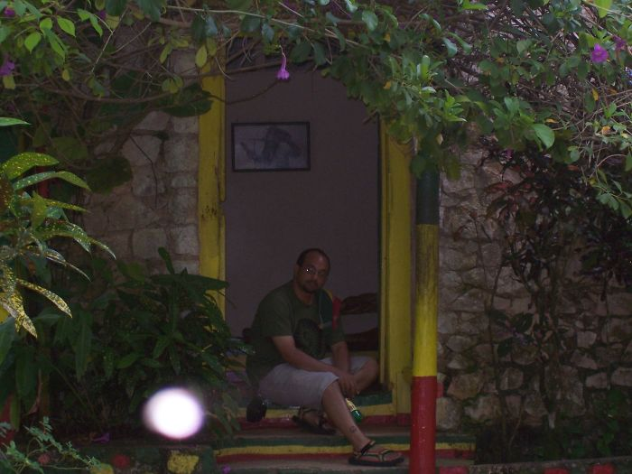 Sitting In The Doorway Of Bob Marley's House At Nine Mile Next To His Mausoleum. The Camera Never Took A Picture With A Spot Before This Shot, And Has Not Taken One Since... The Feeling I Had At The Same Time The Was Indescribable.