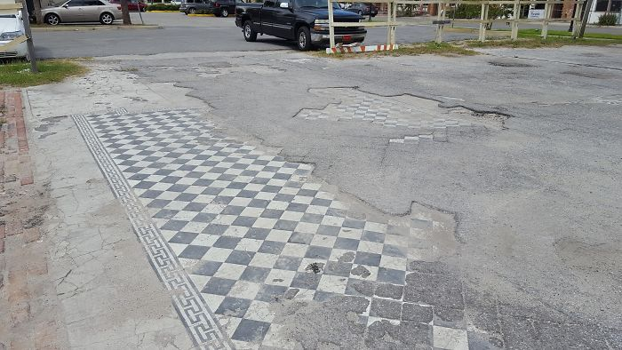 This Parking Lot Used To Be Some Sort Of Building. Instead Of Removing The Old Tile Floor, They Simply Paved Over It