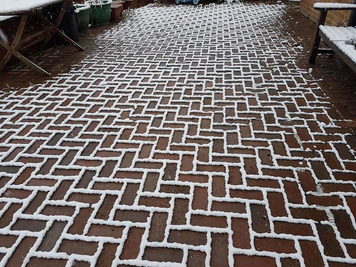 The Snow Has Settled Only On The Outline Of The Bricks On My Friends Driveway