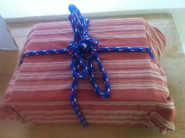 """This Is How My Husbands Wraps Gifts. That Is An Old Tablecloth And Rope... He Said """"What? I'm Going Green"""""""