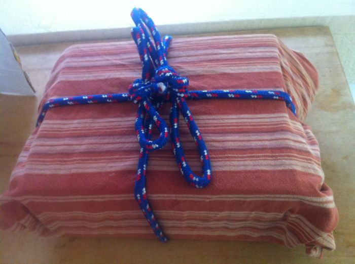 This Is How My Husbands Wraps Gifts. That Is An Old Tablecloth And Rope... He Said