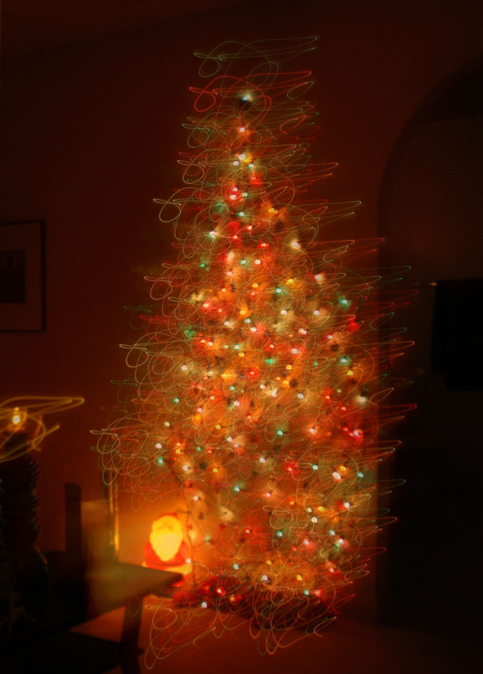 Push-Pin Christmas Tree With Lights. Made With Push-Pins And Strands Of Lights.