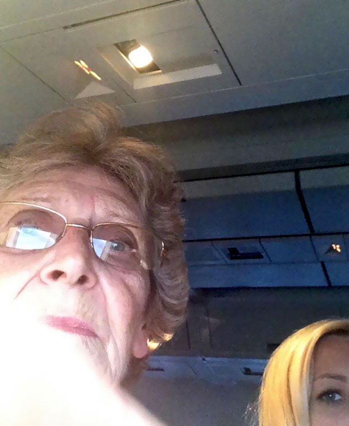On My First Plane Ride, This Woman Offered To Take A Pic Of The Sky For Me But Accidentally Took Selfie Instead
