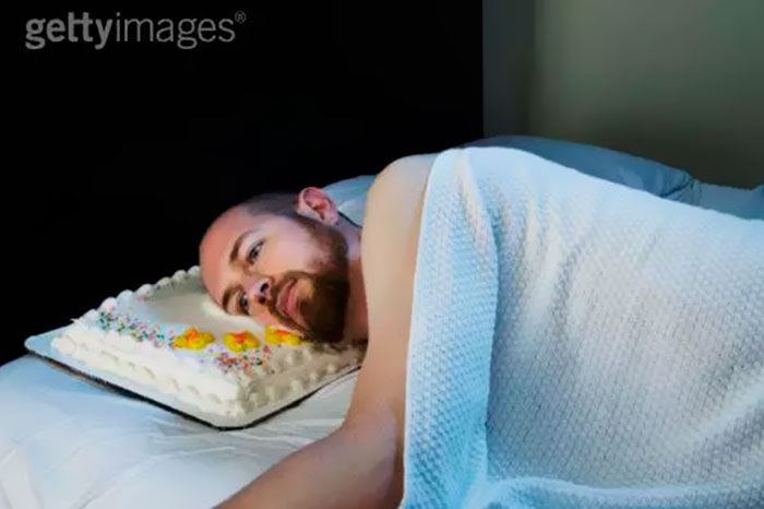 Man With A Cake As A Pillow