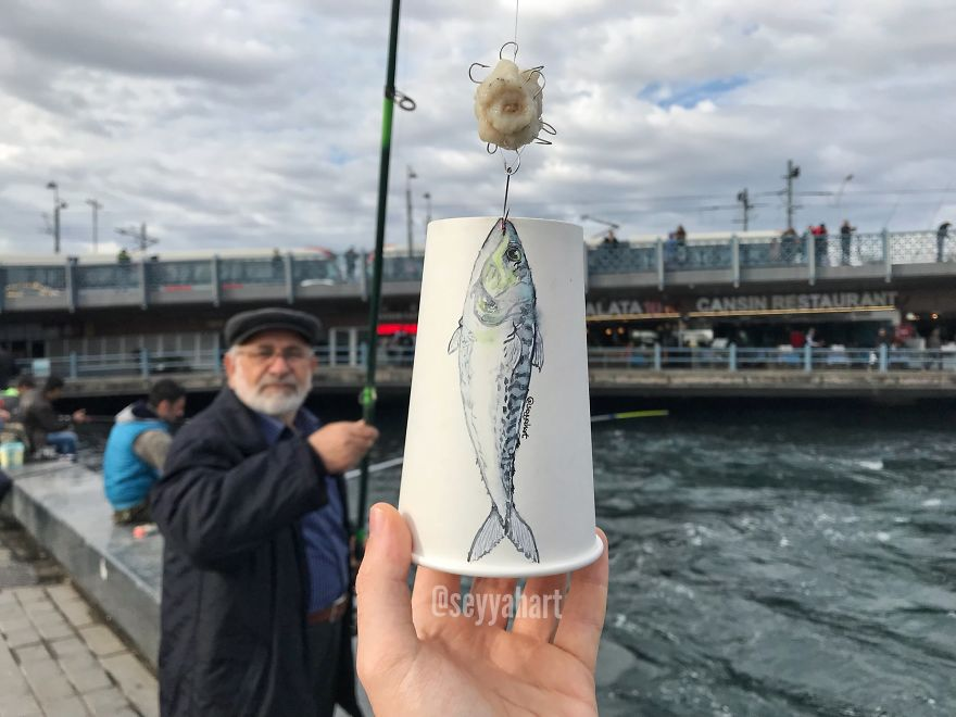 Fisherman Caught The Art On Cup At Galata Bridge.