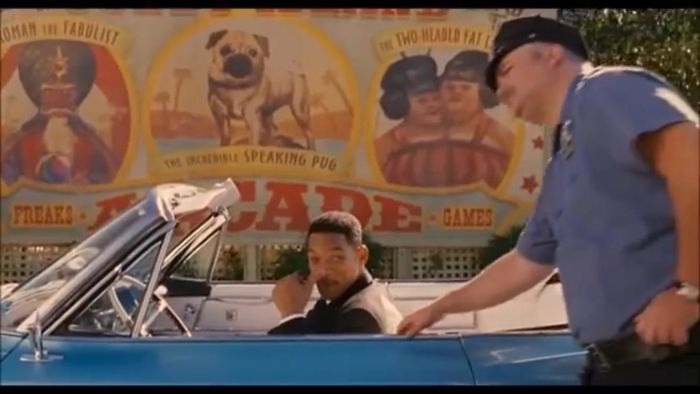 In The Movie Men In Black 2, There's A Talking Pug Named Frank. When Agent J Goes Back To 1969 In Men In Black 3, He Gets Pulled Over By Police In Front Of A Billboard A Advertising A Circus And Featuring A Talking Pug