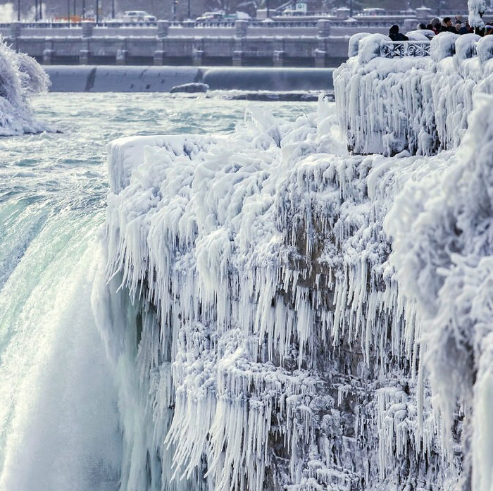 Though Known For Its Hundreds Of Acres Of Lush Terrain And Trails Conducive To Hiking, Niagara Falls State Park Boasts Equally Stunning Views Even As Temperatures Drop And Crowds Thin. Right Now, The Falls Are Completely Coated In Ice — And Absolutely Jaw-Dropping. More Than 3,000 Tons Of Water Flows Over The Falls Every Second. Sometimes The Ice Over The Niagara River At The Base Of The Falls Gets So Thick That People Have Been Known To Build Concession Stands Across It Or Walk Back And Forth Between The U.s. And Canada. Photos By Aaron Lynett/the Canadian Press Via Ap
