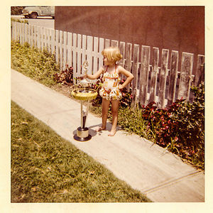 Me In 1958 Standing Next To A Trophy My Dad Had Won That Weekend With His Drag Racing Car. I Was 3 Years Old.