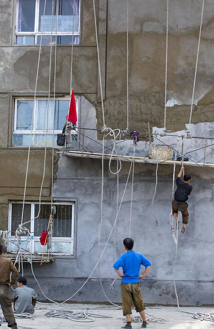 It's Not A Circus, They Are Workers In A Country With Low Safety Standards