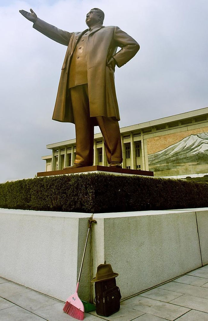 This Is Never Supposed To Happen: A Broom Standing On The Base Of Kim Il Sung's Statue In Mansudae, In Pyongyang