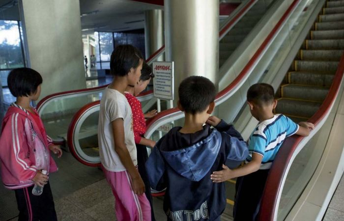 The Pionners Camp Of Wonsan Is Often Visited By Tourists To Show The Youth From All Over The Country Having Fun. But Some Children Come From The Countryside And Are Afraid To Use The Escalators Which They've Never Seen Before