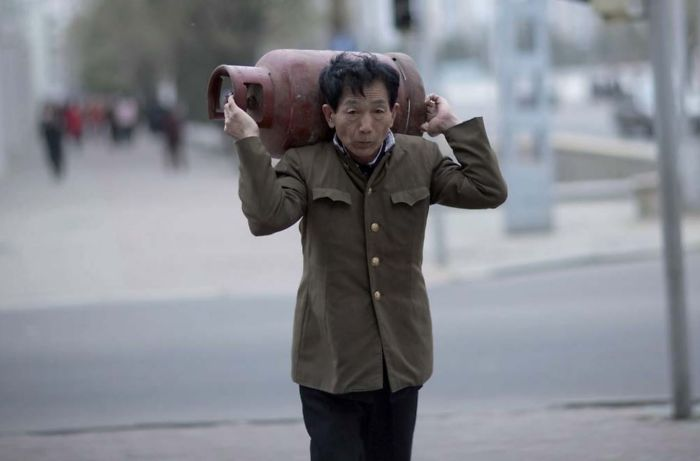 It Is Forbidden To Take Pictures Of The Daily Life Of The North Korean People If They Are Not Well Dressed. For My Guide This Man Was Not Well Dressed Enough To Be Photographed