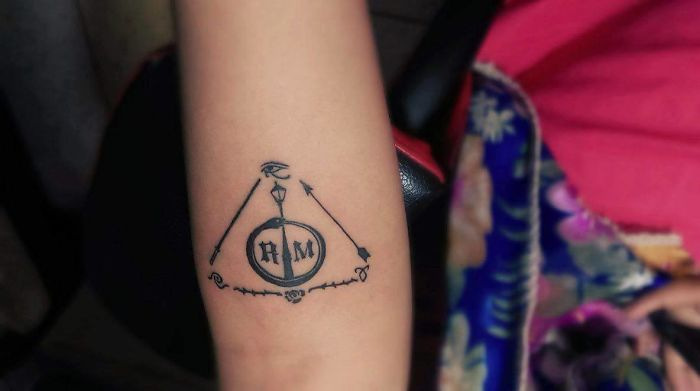 My Fandom Tattoo = Lamppost - Narnia Ouroborus - X Files (Scully Had A Tattoo Like This); Rose N Thorns - The Arcana Chronicles; Antarian Royal Seal - Roswell; Angel Power Rune - The Mortal Instruments; Light Saber - Star Wars; Arrow - The Walking Dead; Wedjat - Egyptian Mythology; R - Dark Matter (Scifi Show Which Has A Space Ship Called Raza); M - The Originals (The Leads Have The Surname Mikaelson); And The Whole Together Forms: The Deathly Hallows - Harry Potter.