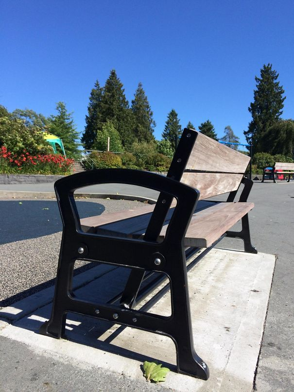 The Back Of This Park Bench Can Swing Back And Forth, Allowing The User To Face Either Direction