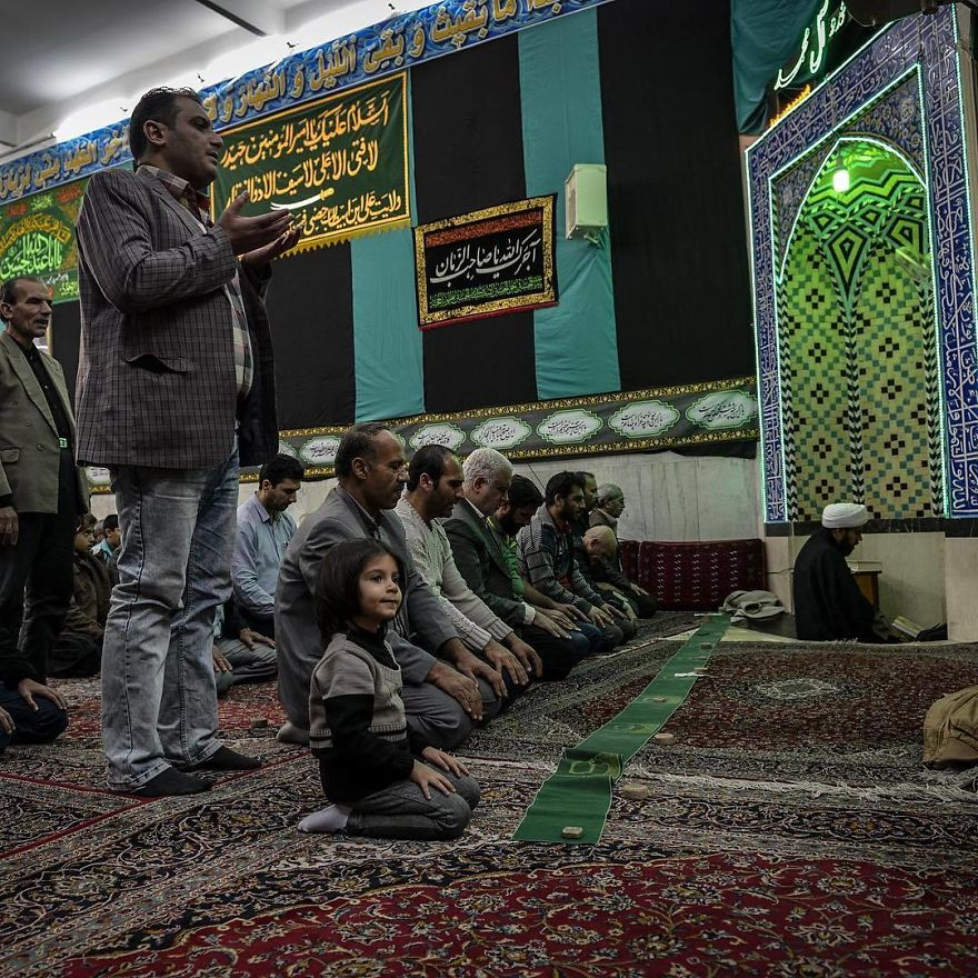 A Father And His Daughter Pray Together In The Mosque