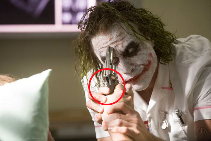 Jokers Thumb On The Hammer In The Dark Knight. Even If Dent Pulled The Trigger, The Hammer Wouldn't Fall