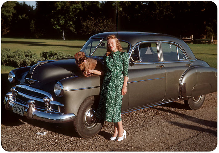 A Girl With A Dog And A Chevrolet Styleline Deluxe 4 Door, 1950