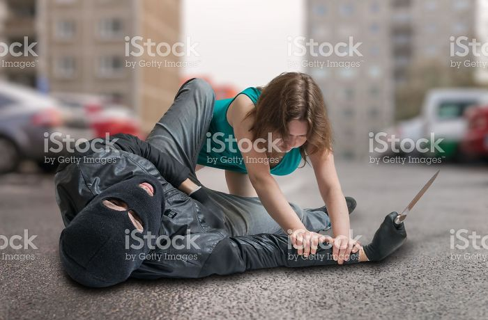 Woman Tackling A Mugger Who Forgets He Has Two Hands