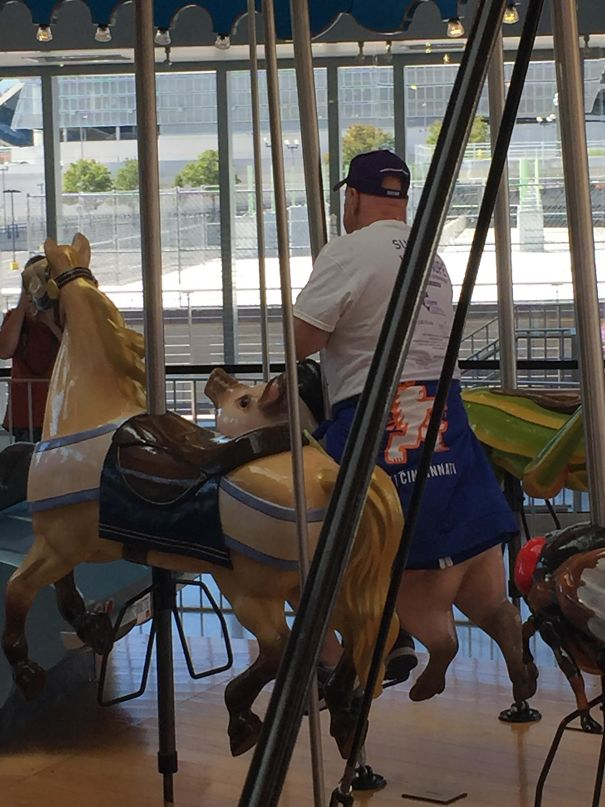 This Man On A Carousel Looks Like He Has Pig Legs