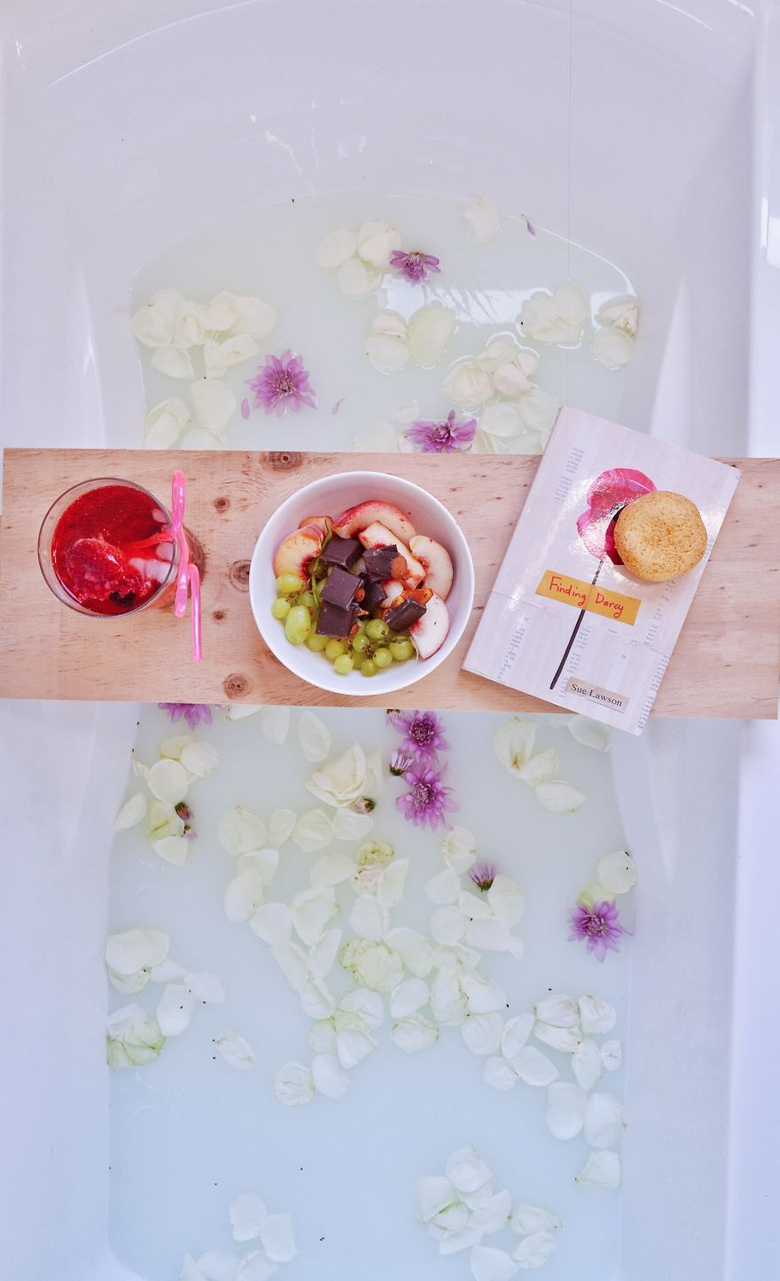 Why Read In Bed When You Can Soak In A Hot Bath With The Full Aroma Of Freshly Picked Flower Petals?