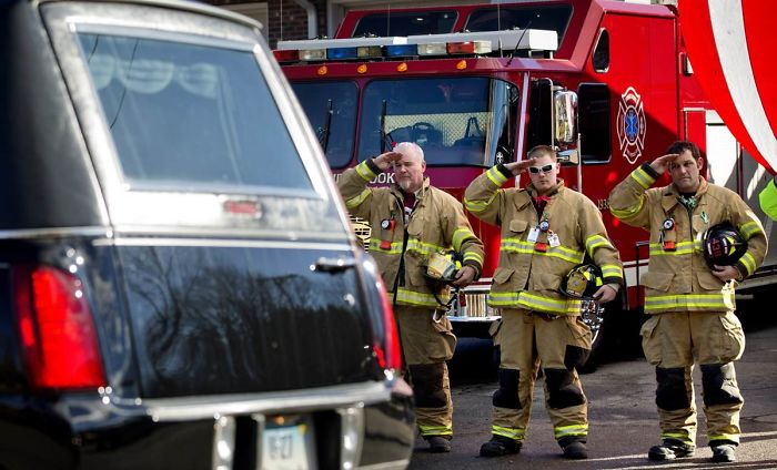 Firefighters Salute As A Hearse Passes For The Funeral Procession To The Burial Of 7-Year-Old Sandy Hook Elementary School Shooting Victim Daniel Gerard Barden, Wednesday, Dec. 19, 2012