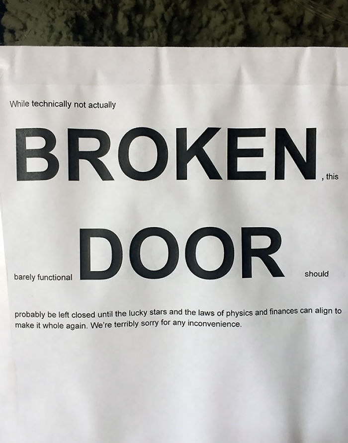 Detailed Broken Door Sign At A Coffee Shop