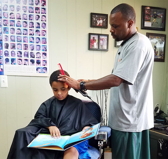 Kids Get A $2 Discount If They Read A Book Aloud To This Barber In Michigan