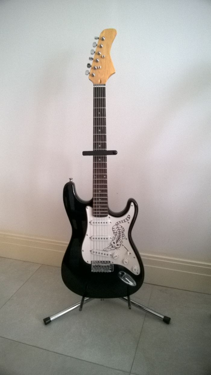 A Guitar I Built From A Kit For My Wife. Had To Re-Do The Paintjob Twice, Lost Counting The Hours Spent On This Project (And The Number Of Spraycans Too).