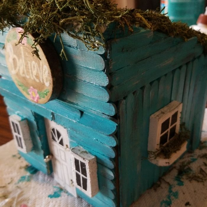 Fairy House Made Of Repurposed Wood Scraps, Popsicle Sticks, And Glue.