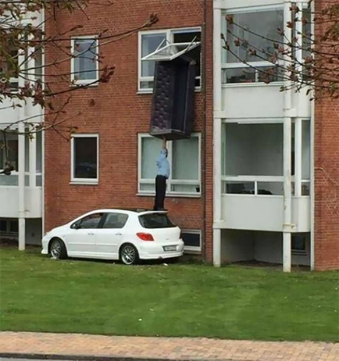 Hey, You Push This Couch Out The Window, I'll Stand On My Car And Grab It