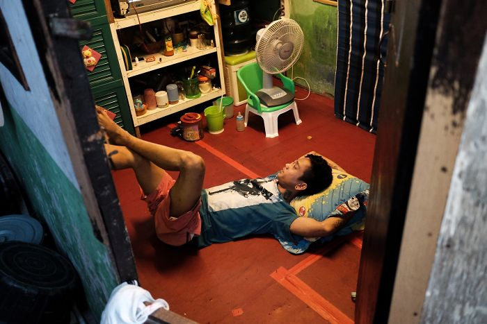 Young Man Relaxing In His Small House