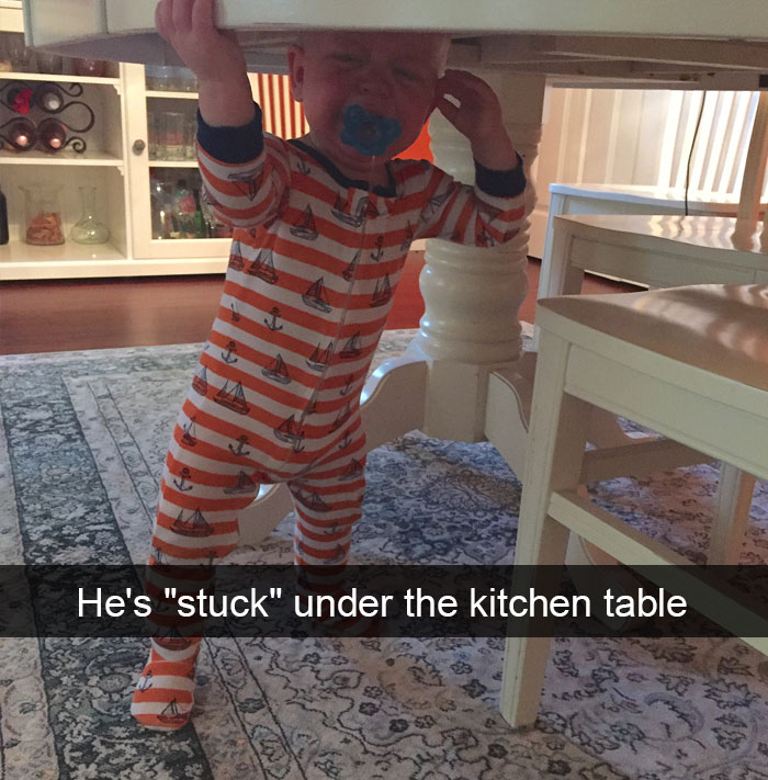 """He's """"Stuck"""" Under The Kitchen Table"""