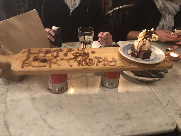 It's My Birthday Today And Someone Told The Restaurant. Birthday Brownie Technically Came On A Plate, However Said Plate Was Placed On A Board Propped Up By Two Tomato Cans