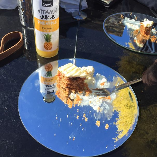 Carrot Cake Served On Round Mirrors