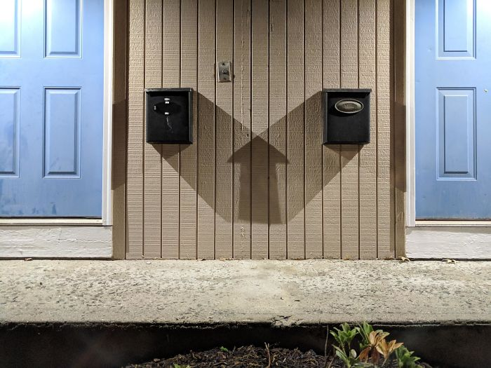 The Shadow Of Two Mailboxes Makes A Perfect Up Arrow