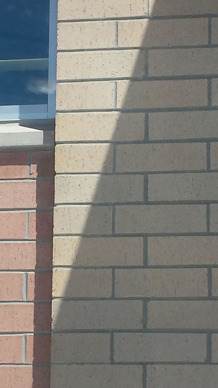 These Bricks Look Slightly Shifted At The Edge Of The Shadow