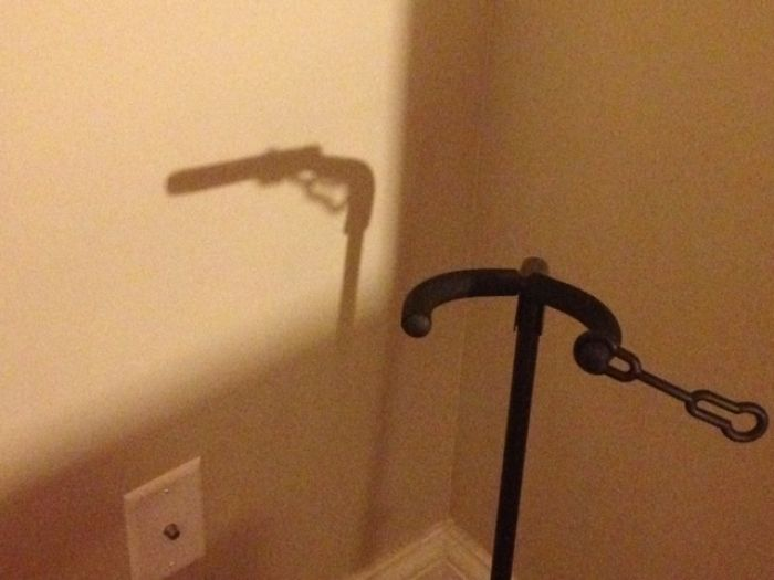 The Shadow Of My Guitar Stand Looks Sort Of Like An 18th-Century Gun