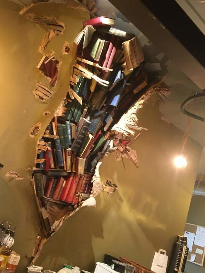 This Coffee Shop Wall With Books Crashing Through