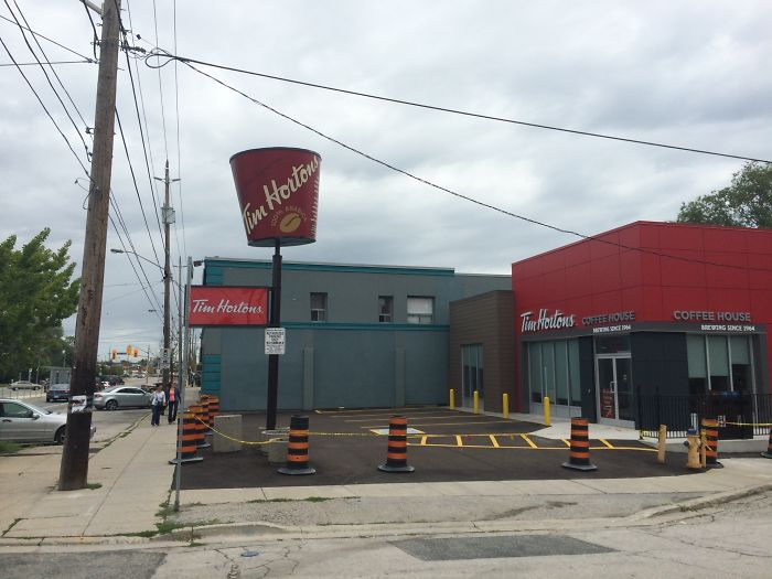 This Tim Hortons Turned An Old KFC Bucket Sign Into A Giant Coffee Cup