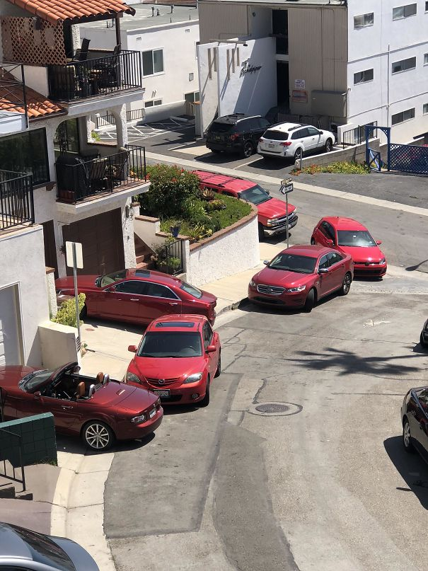 All These Red Cars Strangely Collected On My Street