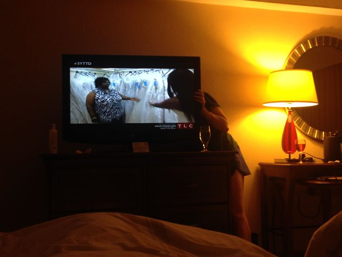Took A Pic Of My Drunk Friend Trying To Fix Our Hotel TV... And She Ended Up In