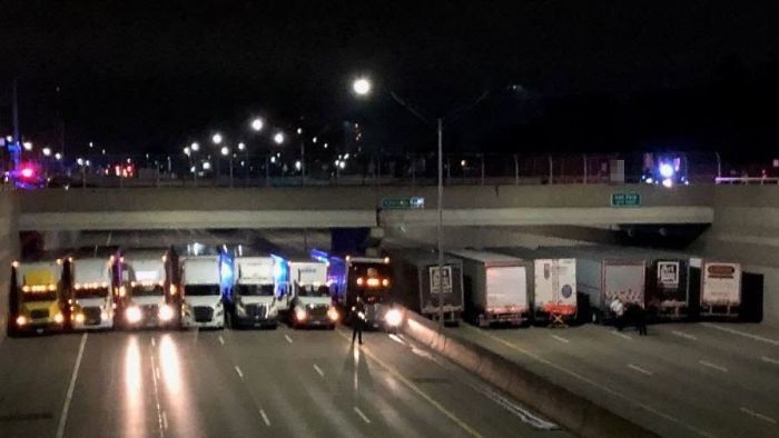 13 Truck Drivers Park Side-By-Side Under A Bridge To Stop Man From Committing Suicide