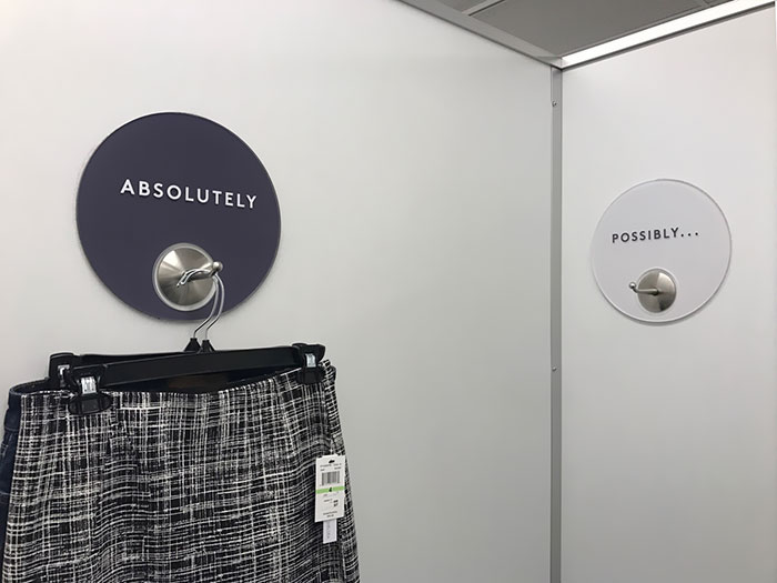 This Dressing Room Has Their Clothing Hooks Labeled In A Very Minimalist Way