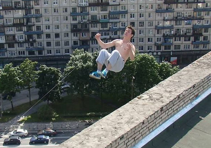 This Photo Shows Parkour Enthusiast Pavel Kashin Performing The Trick That Would Lead To His Death. He's Pictured Attempting To Back-Flip To The Wall, But He Would Soon Lose His Balance And Fall To Ground Below