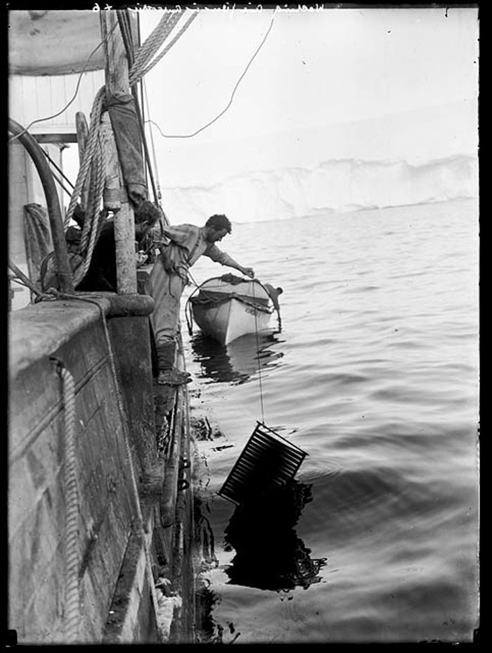 "Frank Hurley Washing Cinematograph Film On The ""Aurora"""