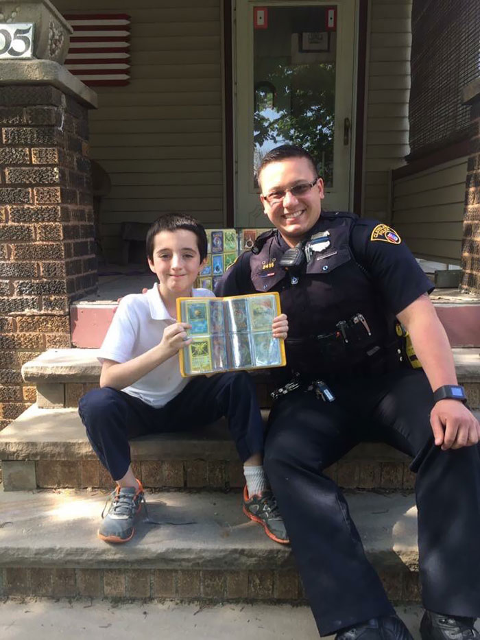 Yesterday, This Kid Had His Pokemon Card Collection Stolen Right Out Of His Hands. After His Shift, A Local Police Officer Went Home And Gathered His Own Collection To Give To The Kid